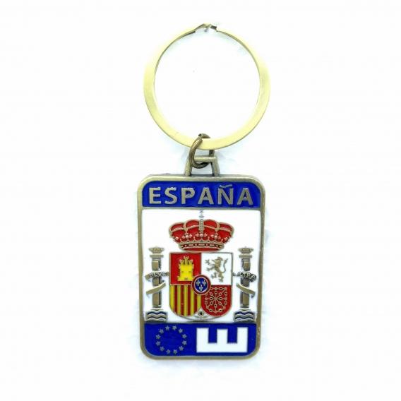 Llavero en forma de matricula con grabado del escudo de España