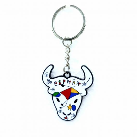 Llavero blanco de cabeza de toro de España con dibujos de colores